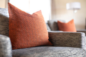 textured-throw-pillow-and-chair