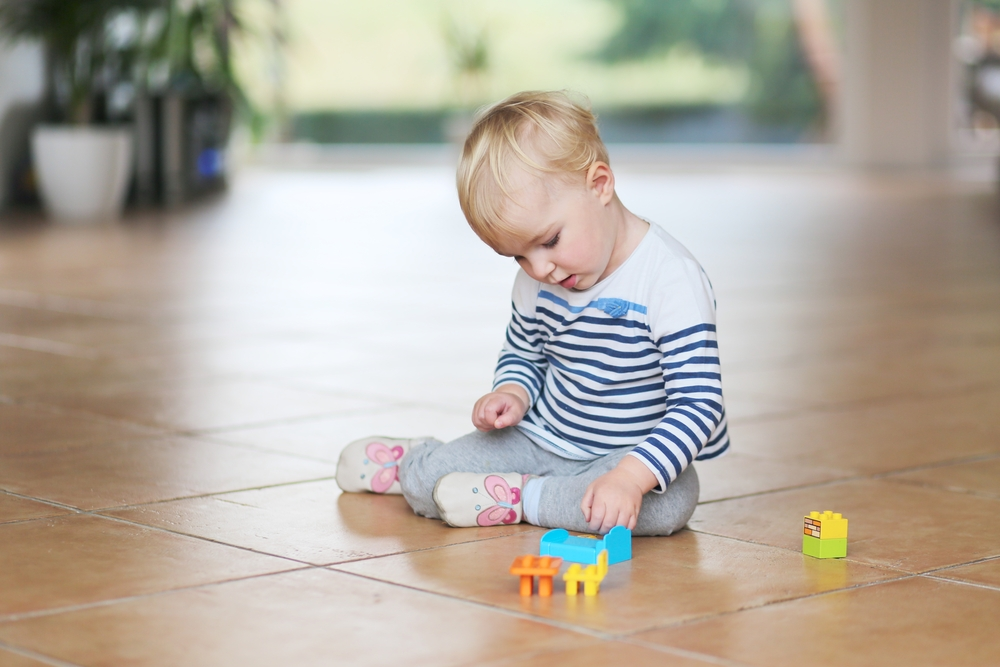baby-playing-on-ceramic-floor